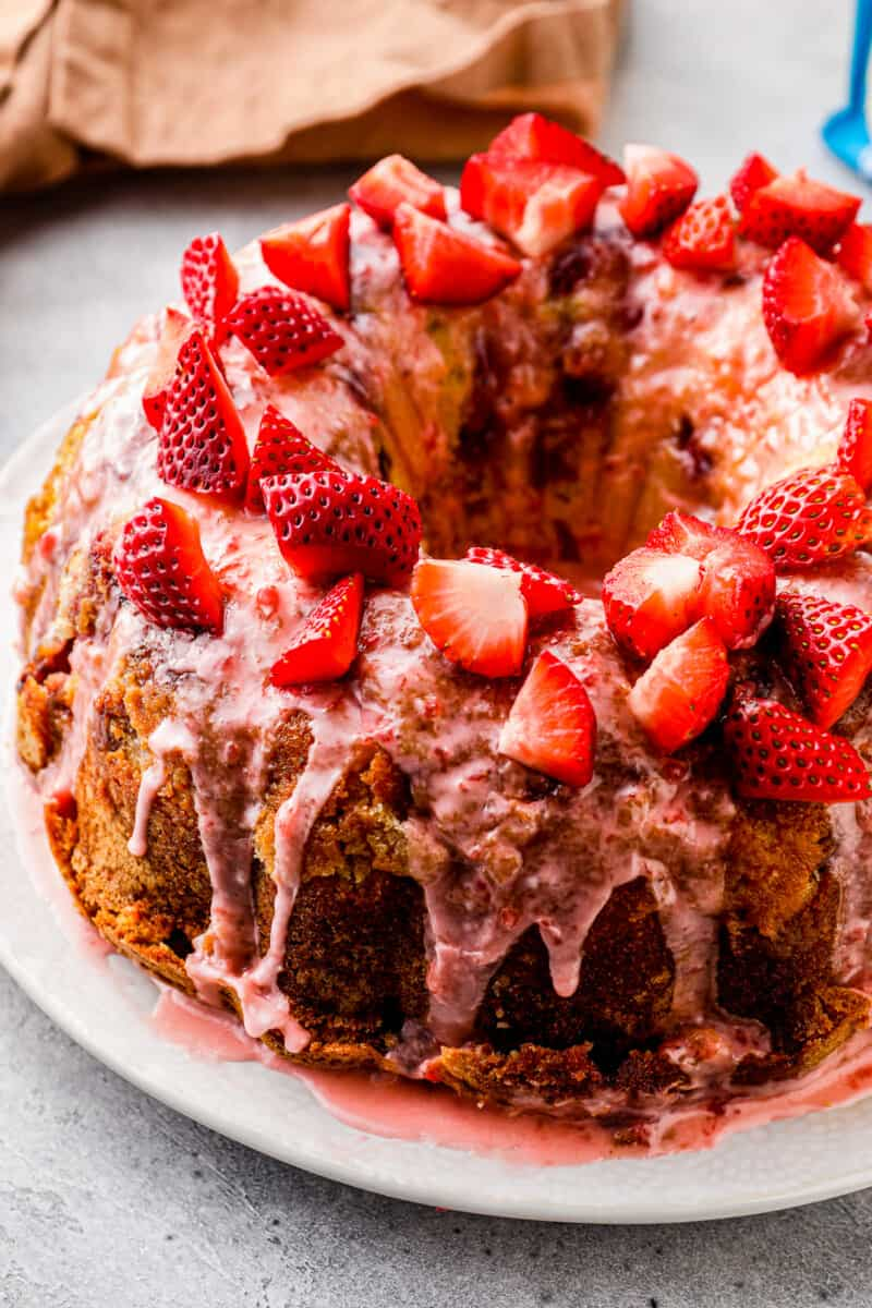 side shot of strawberry pound cake with strawberry glaze