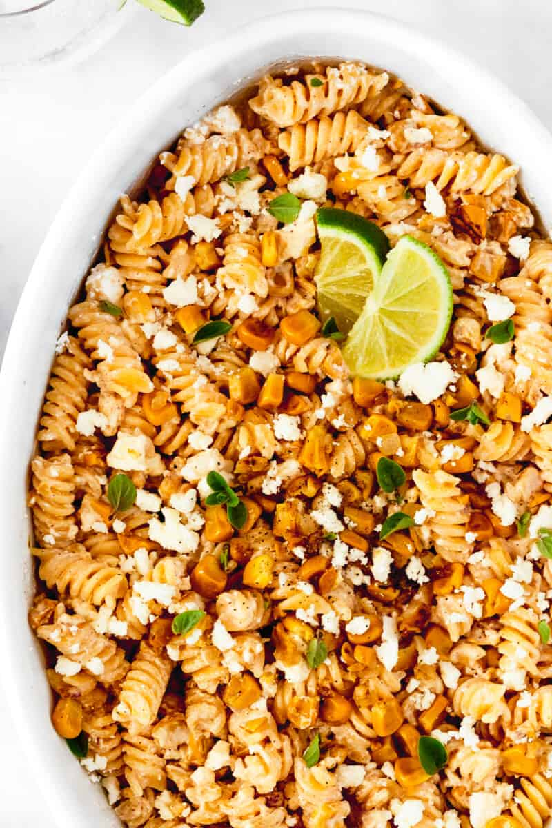 up close white serving platter with street corn pasta salad