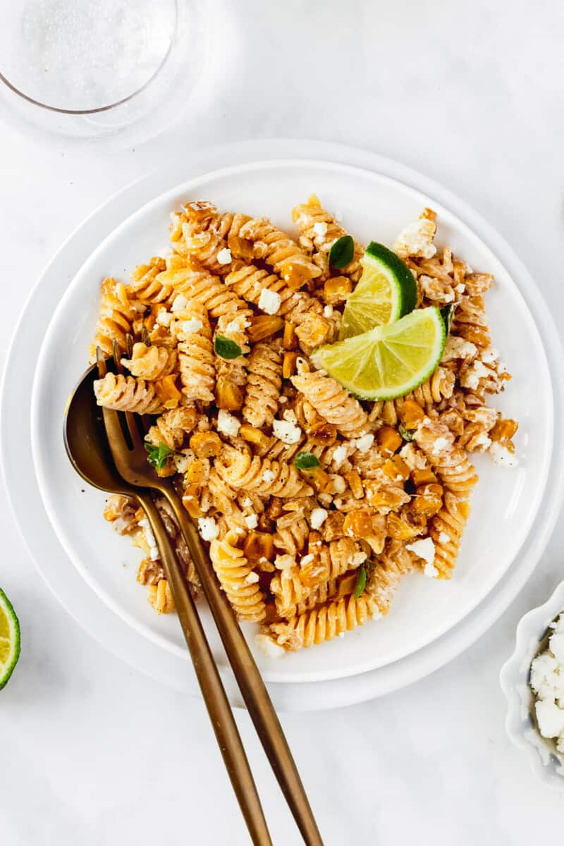 white plate with mexican street corn pasta salad