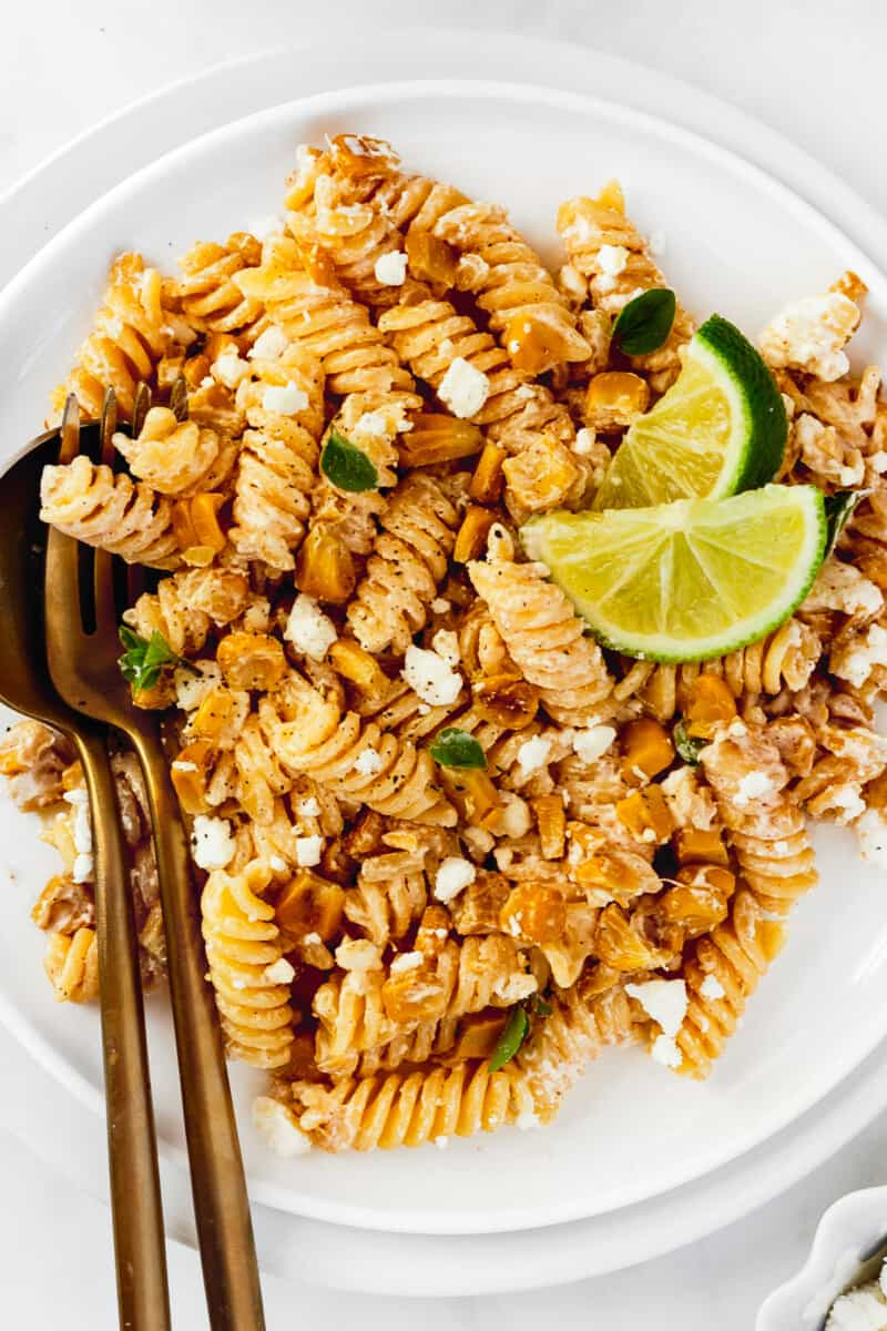 up close white plate with mexican street corn pasta salad