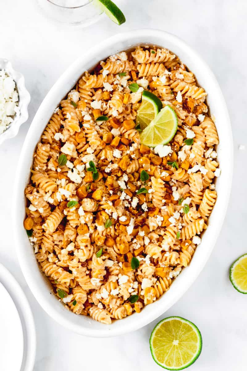white serving platter with street corn pasta salad