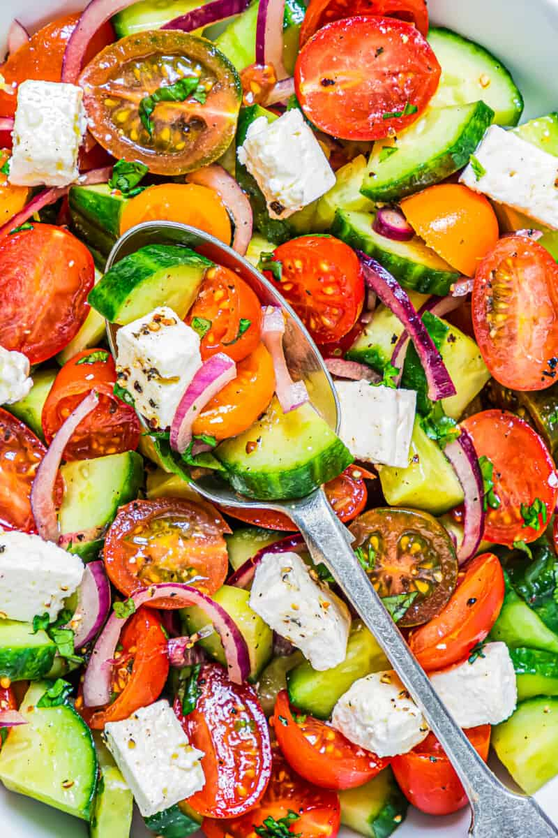 spoon in cucumber tomato salad