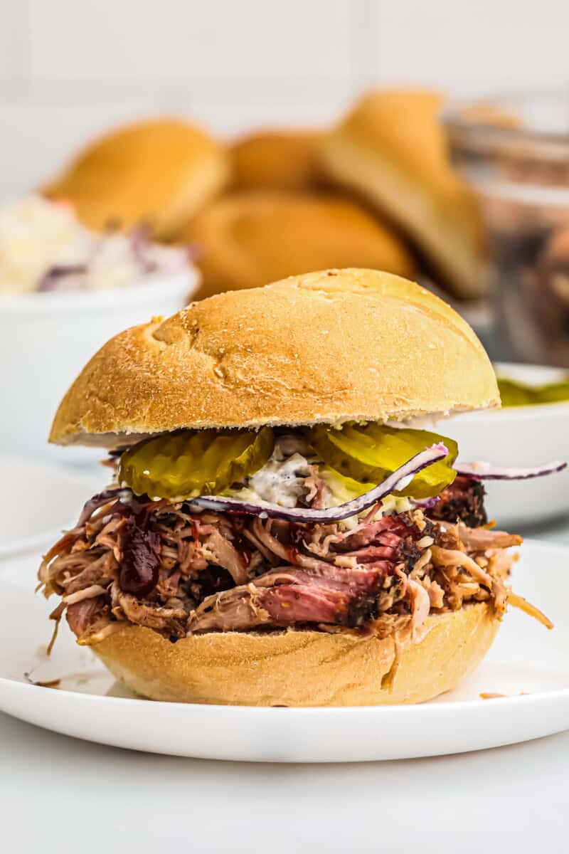 smoked pulled pork sandwich with pickles