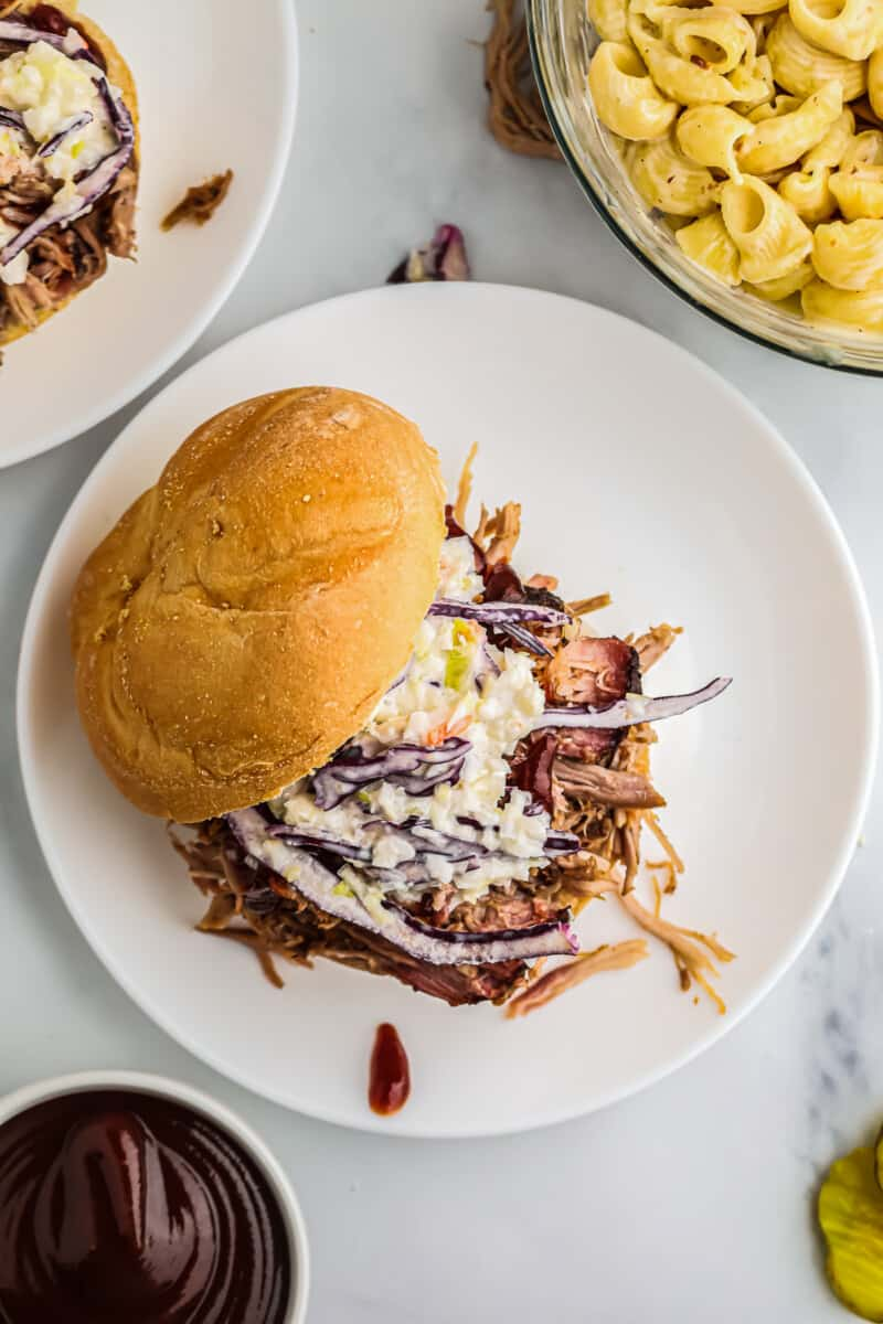 smoked pulled pork sandwich on plate