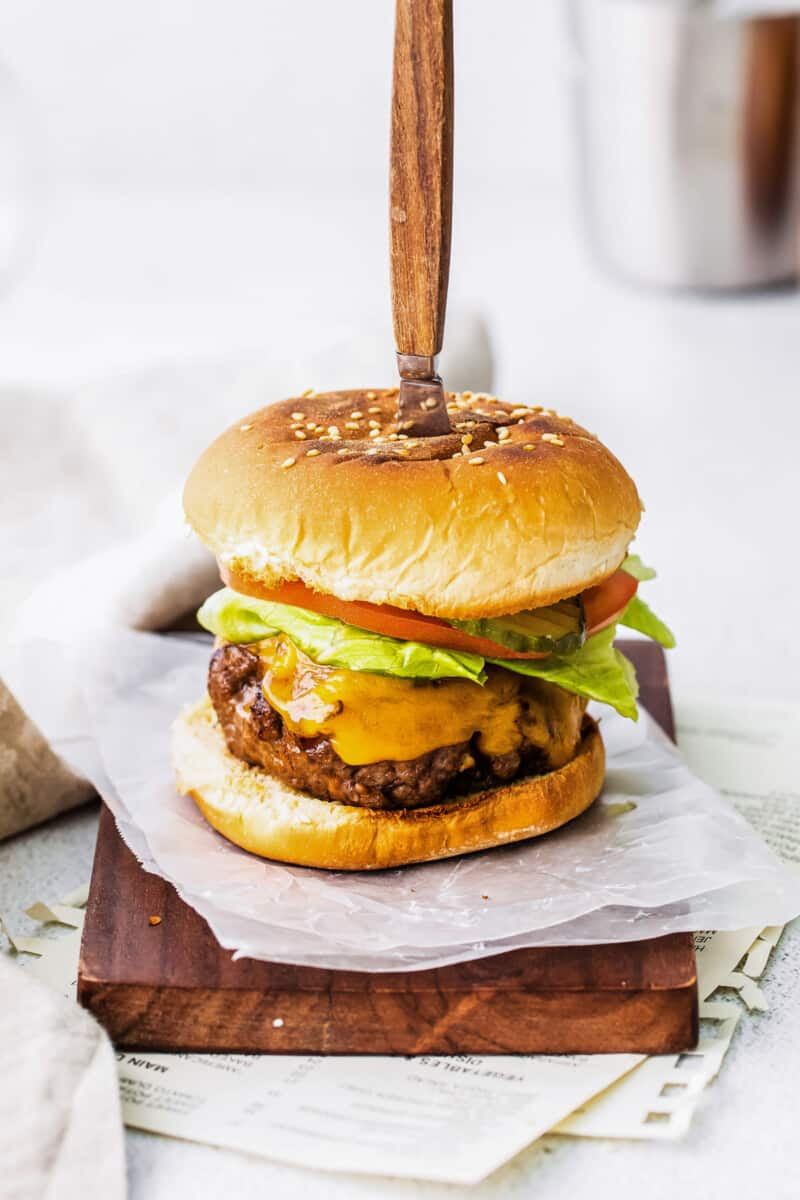 air fryer bbq burger with knife in top