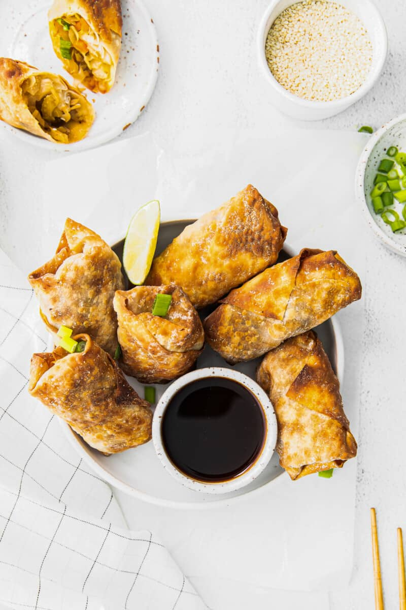 overhead air fryer egg rolls next to bowl of soy sauce