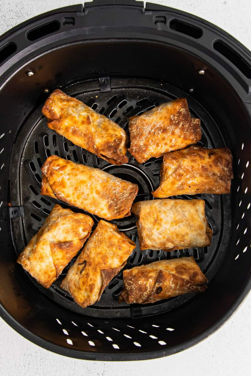 air fryer with egg rolls inside
