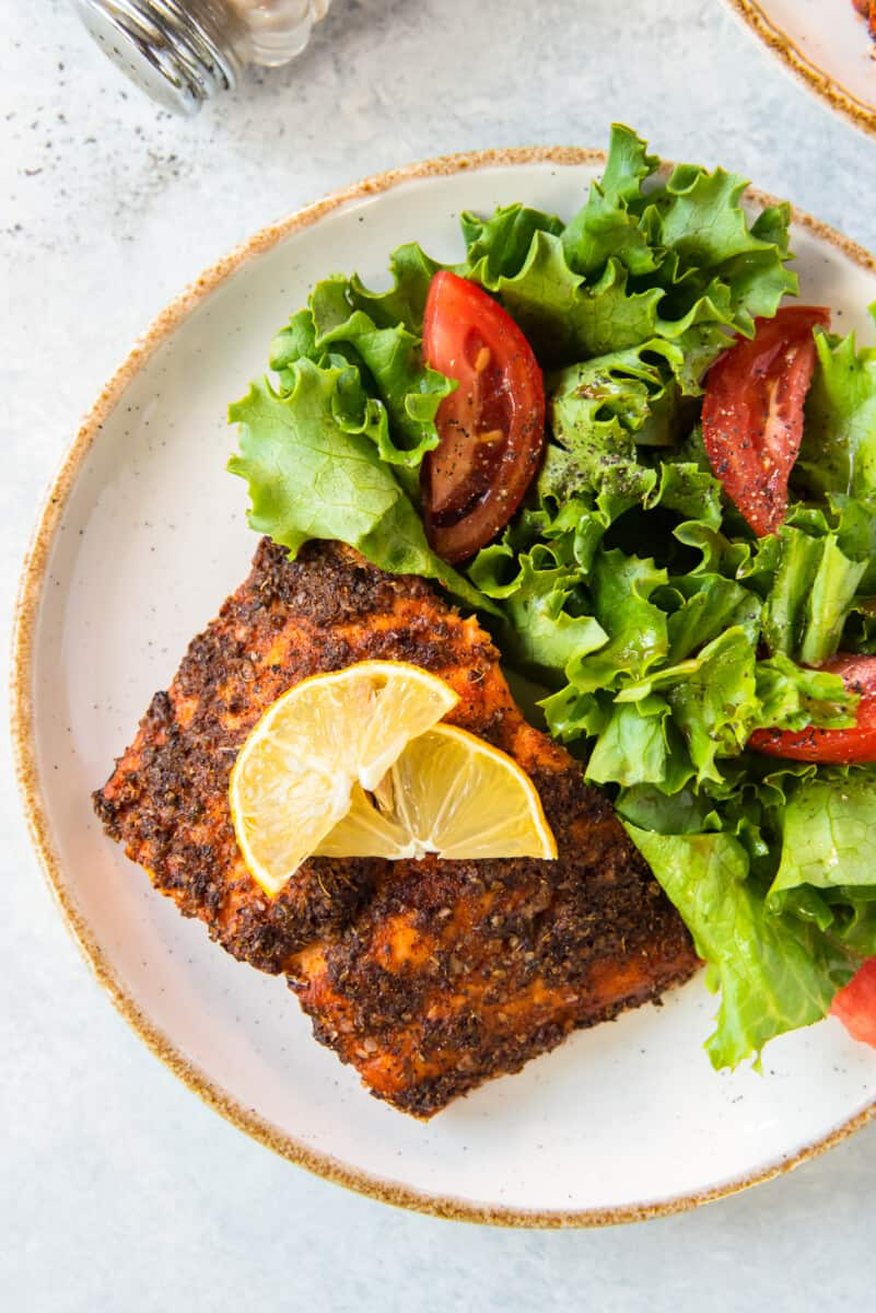 air fried salmon on plate with salad