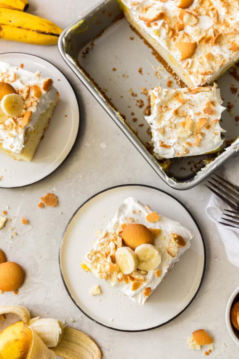 banana pudding poke cake on plates and in baking dish