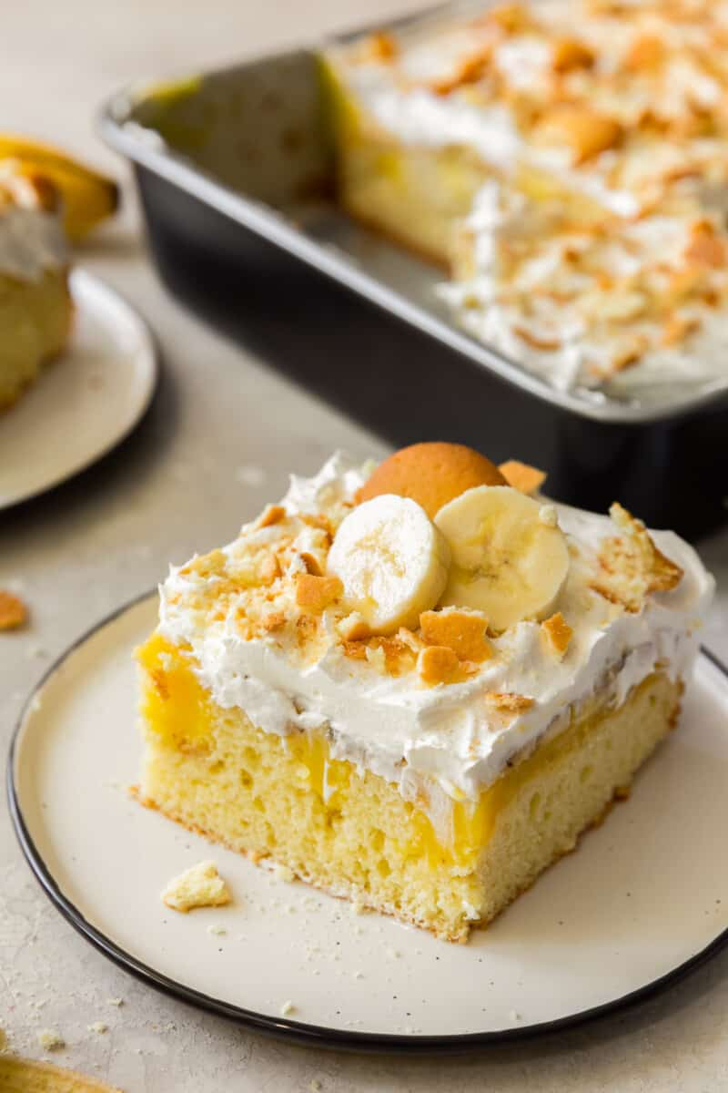 slice of banana pudding poke cake with vanilla wafers