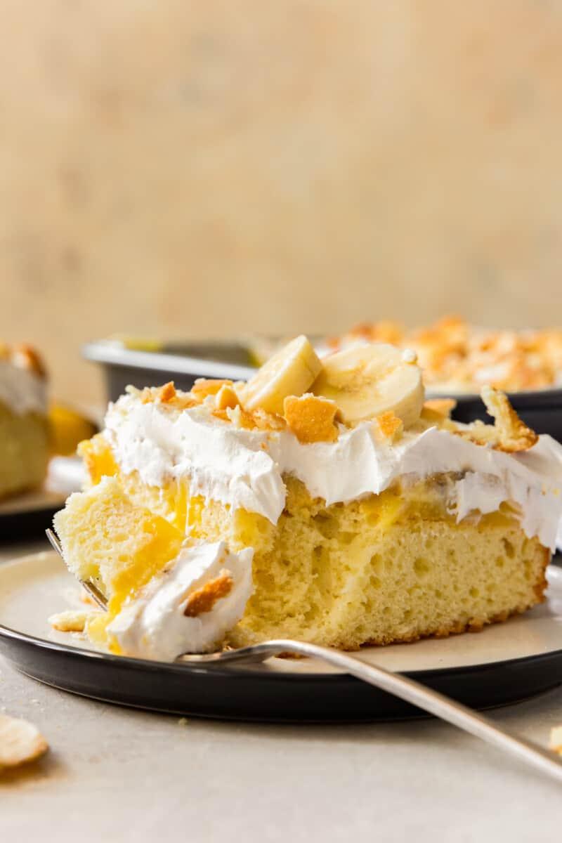bite out of banana pudding poke cake