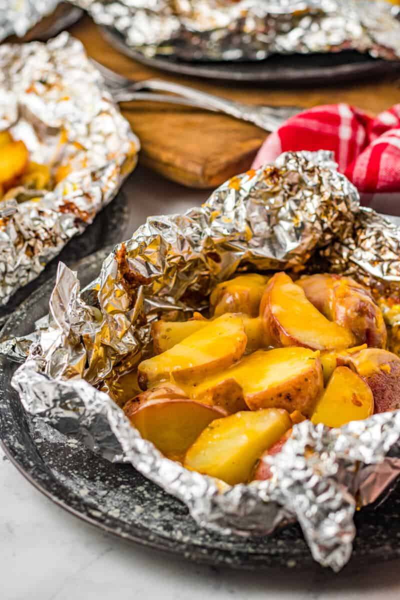 grilled ranch potatoes with cheese in foil packet