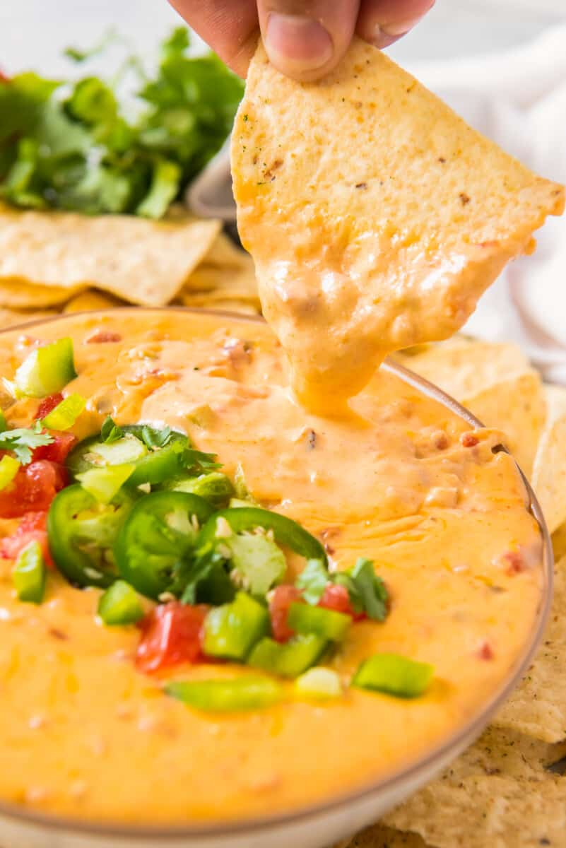 chip dipping into instant pot queso