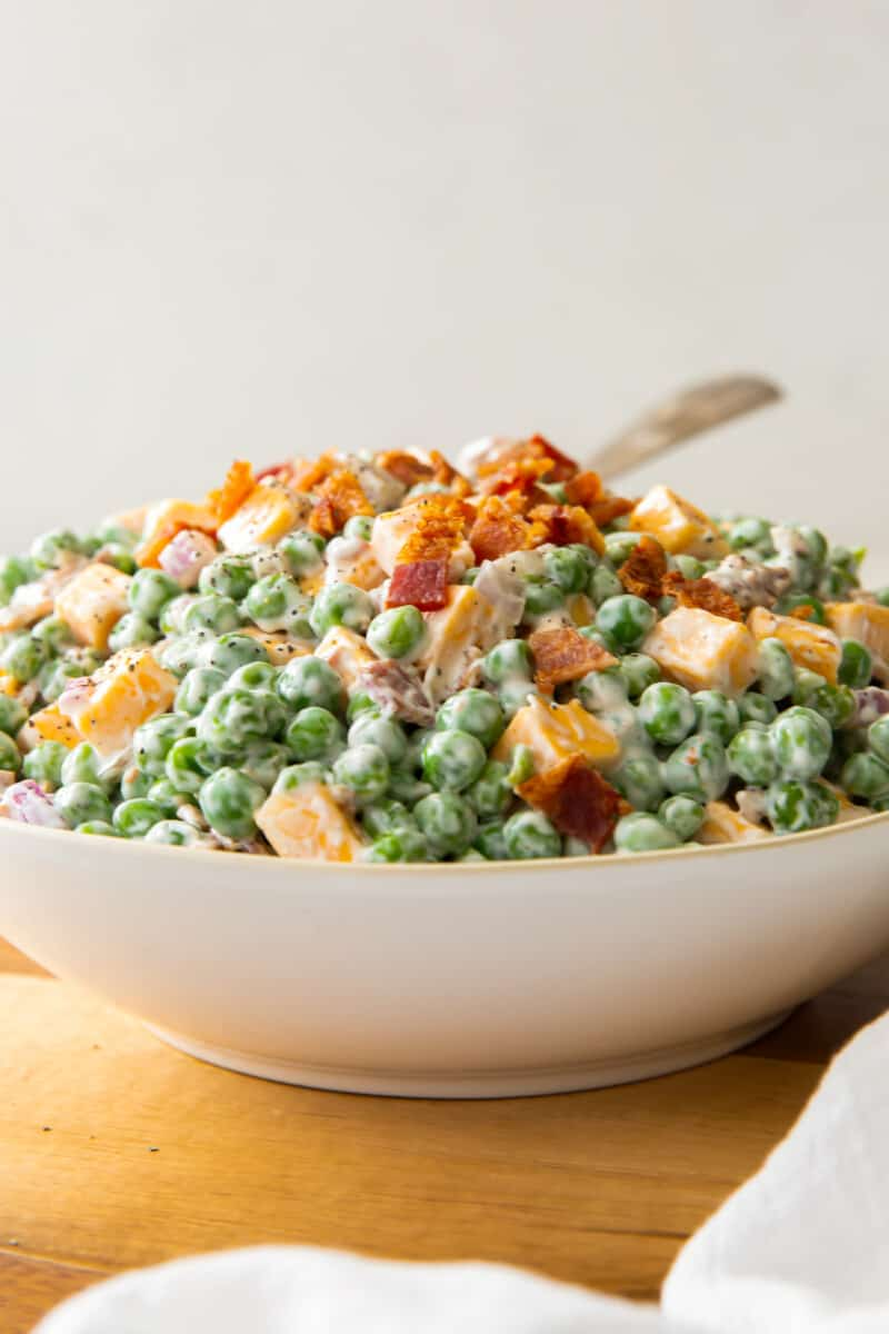 bowl of pea salad with cheese and bacon