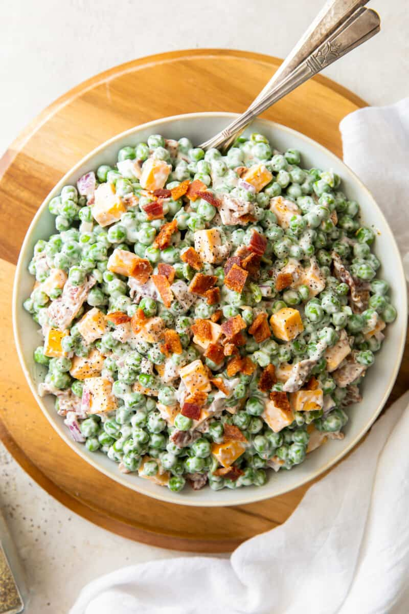 bowl of creamy pea salad with bacon
