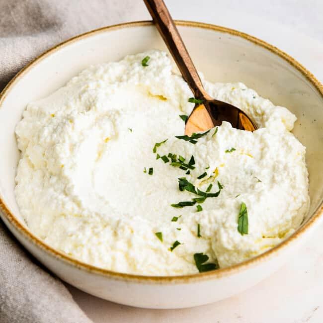 spoon in ricotta in bowl