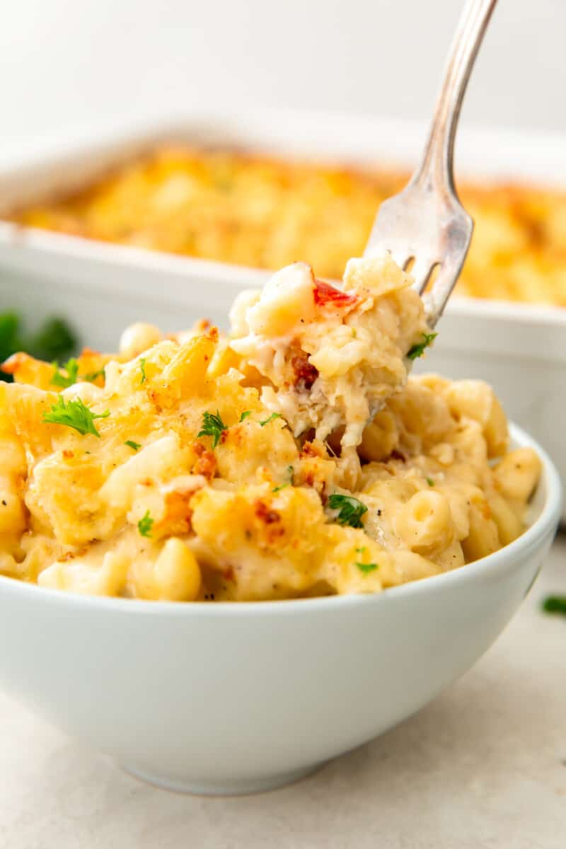 bowl of lobster mac and cheese with fork