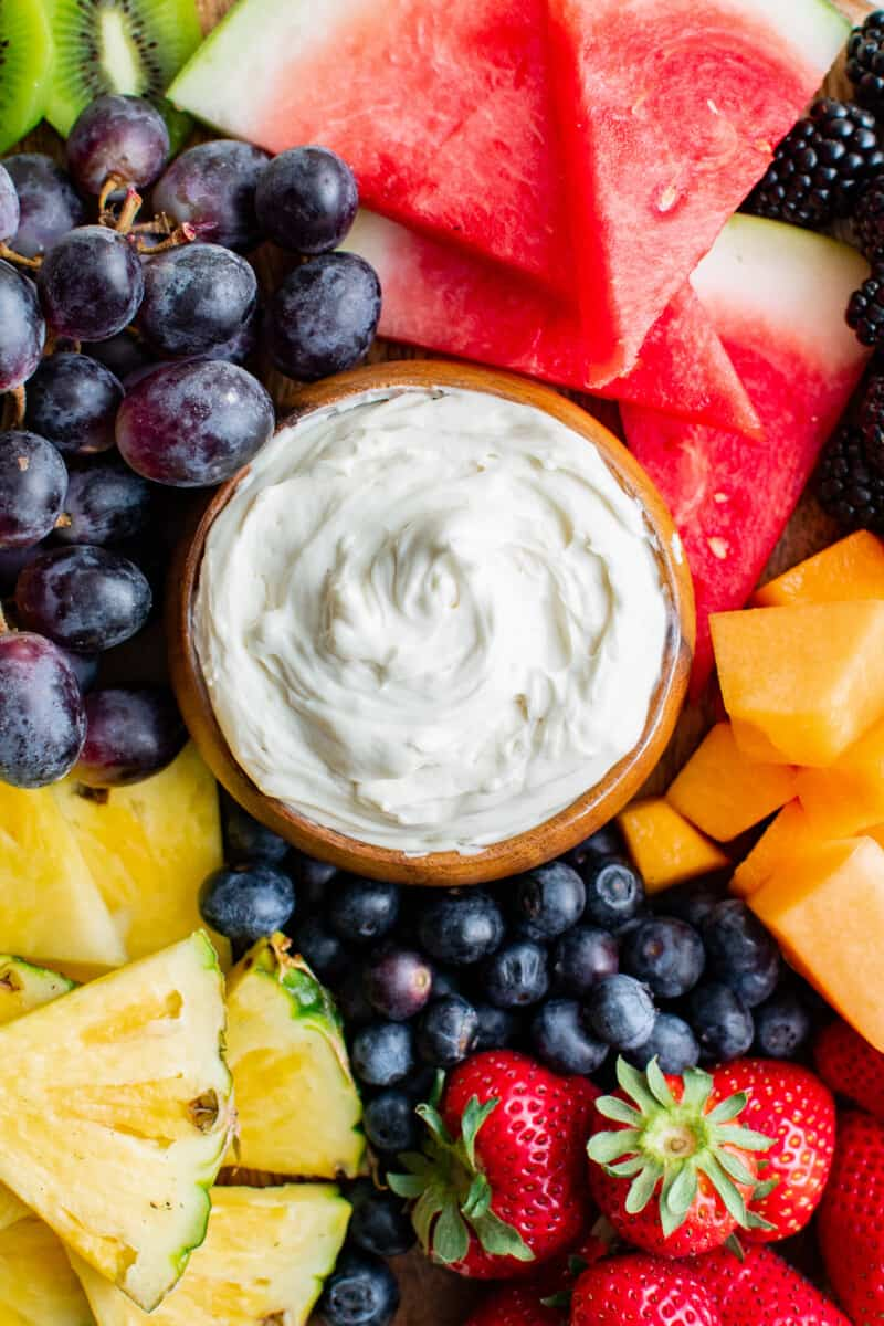 fruit board with cream cheese fruit dip in the middle