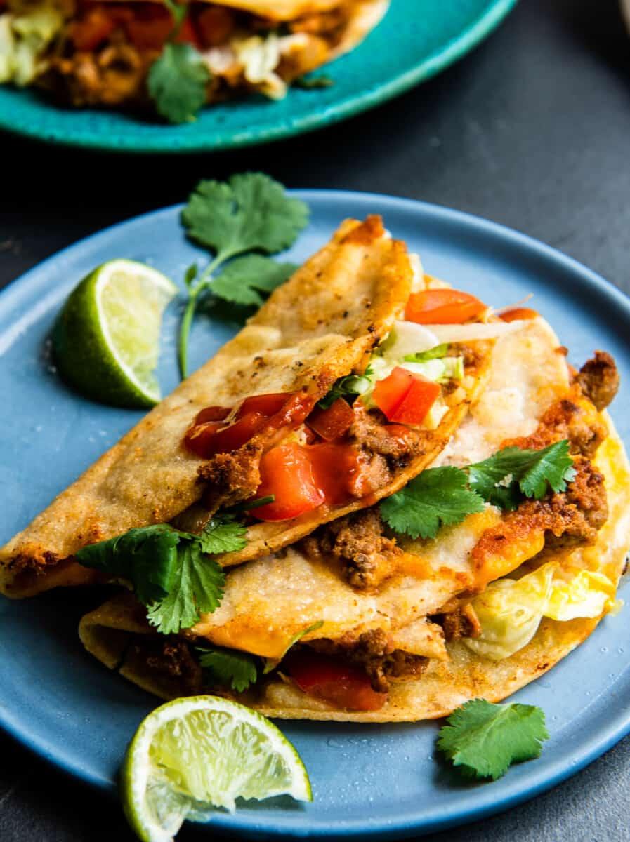 crispy turkey tacos on turquoise plate