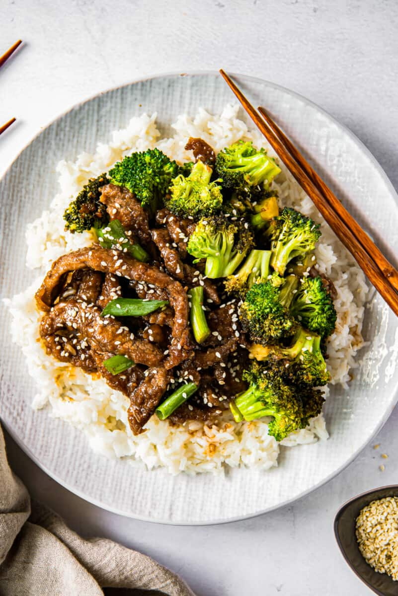 Mongolian beef and broccoli on white plate with rice