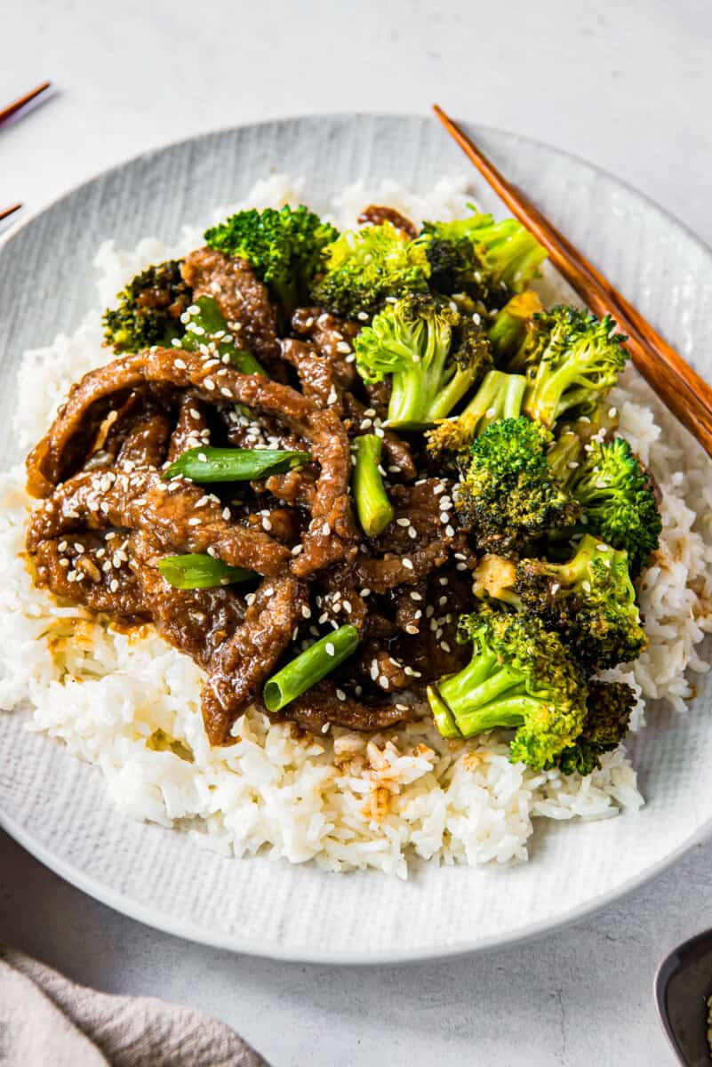 up close Mongolian beef and broccoli on white plate with rice