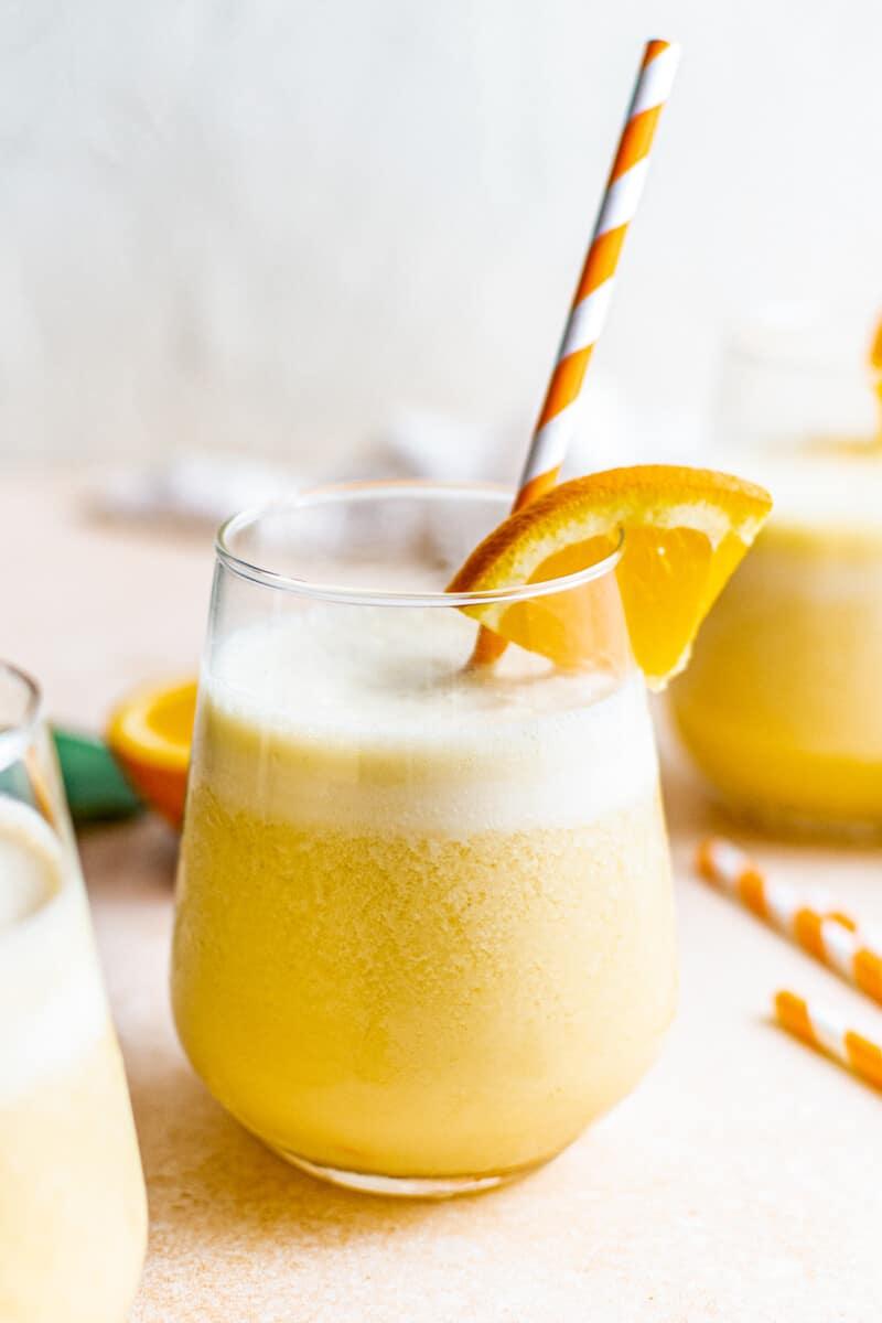 homemade orange julius with striped straws