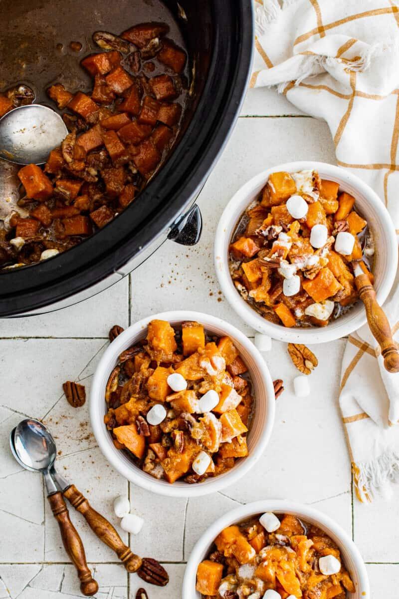 three white bowls with crockpot sweet potato casserole