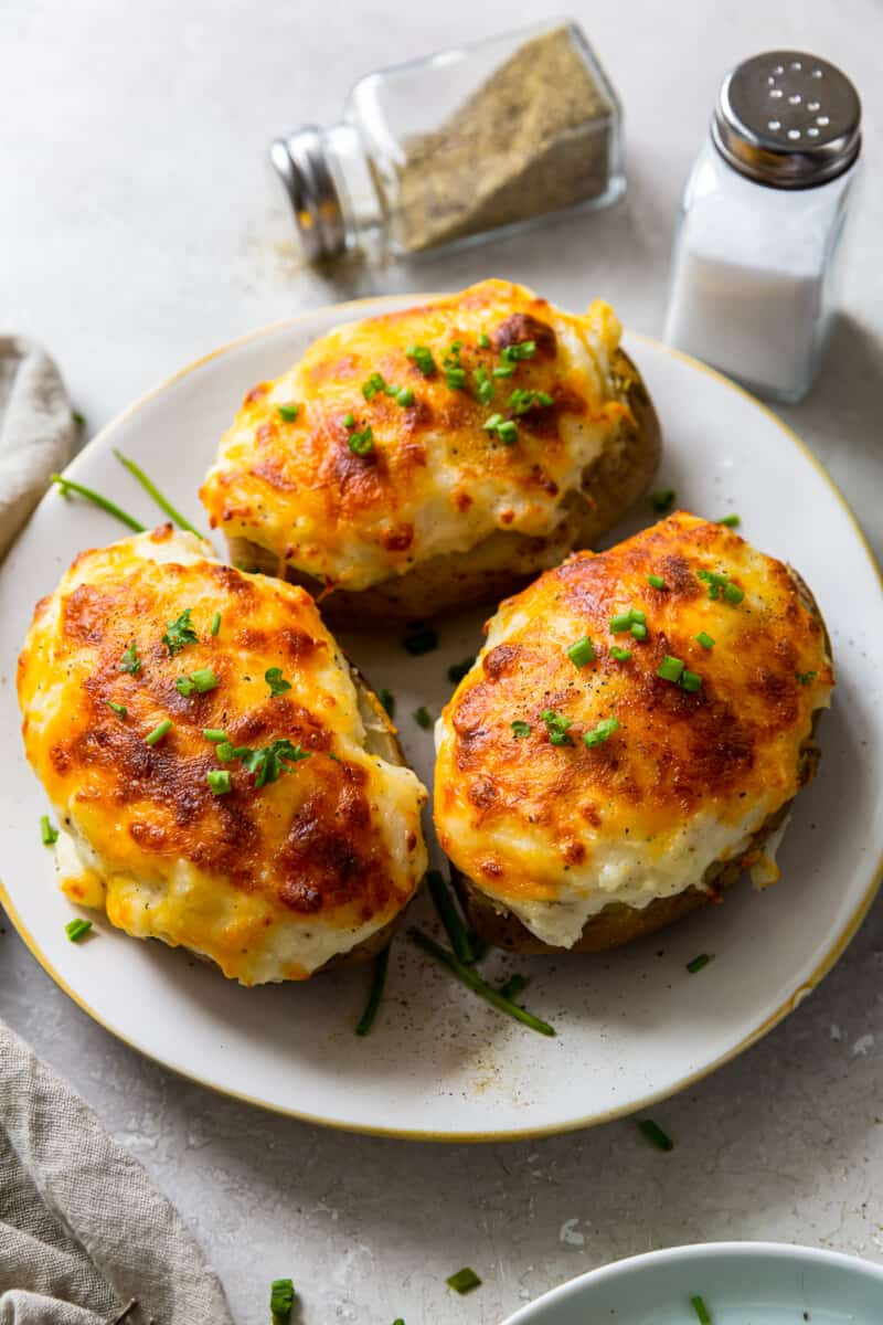 three instant pot twice baked potatoes on plate