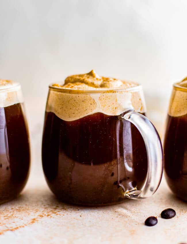 3 clear mugs with pumpkin cold foam coffee