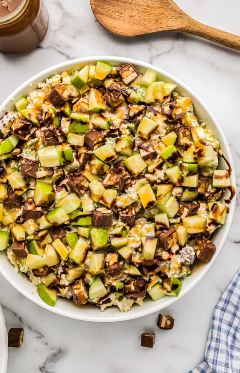 white bowl filled with snickers apple salad