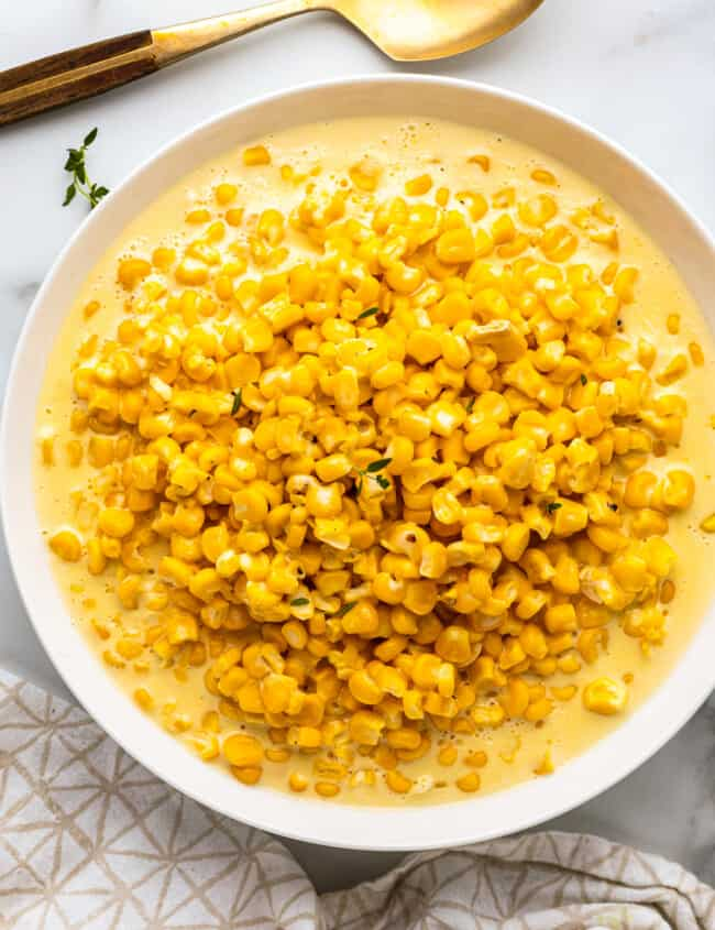 white glass bowl with creamed corn