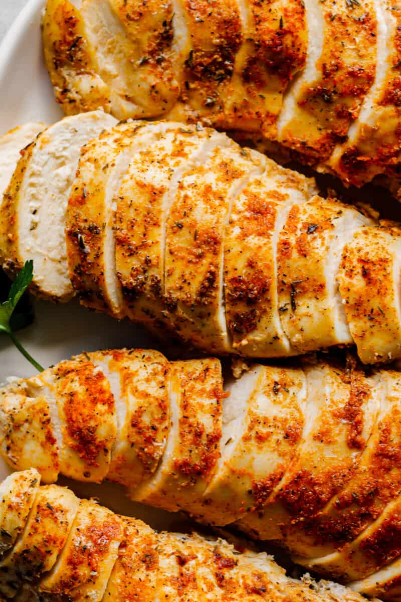up close sliced crockpot chicken breasts with spice rub